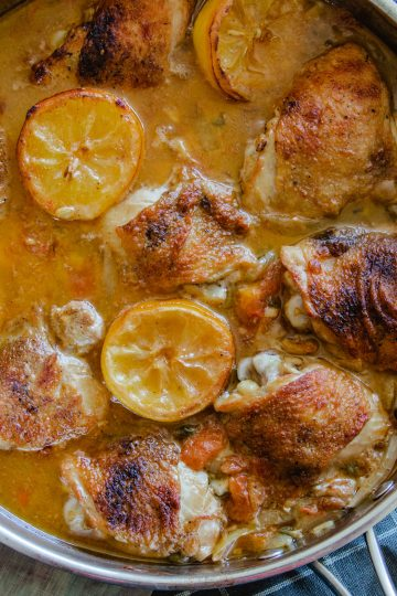 Oven braised chicken thighs with lemons and capers
