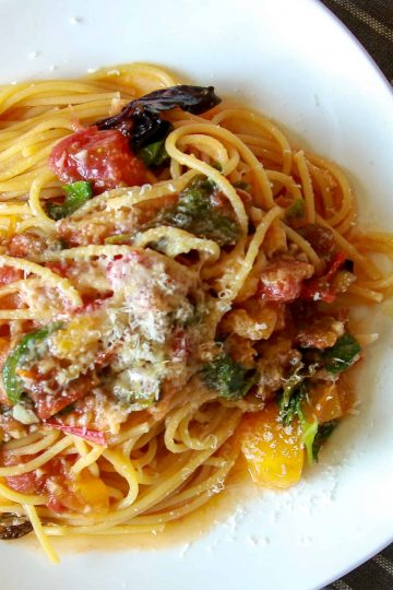 A plate of summer spaghetti on a tablecloth