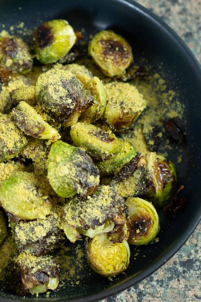 roasted brussels sprouts sprinkled with nutritional yeast