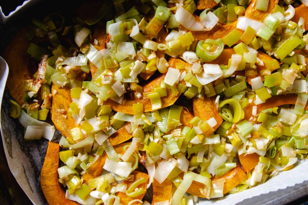 roasted squash and leeks in a baking dish