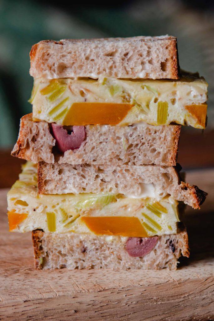 baked omelette sandwich on olive bread
