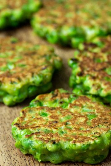 green-pea-fritters-on-a-wooden-cutting-board