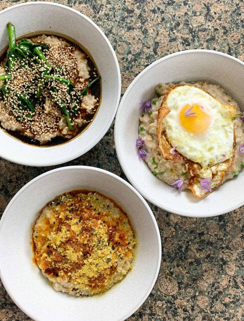 three bowls of savoury porridge with different toppings